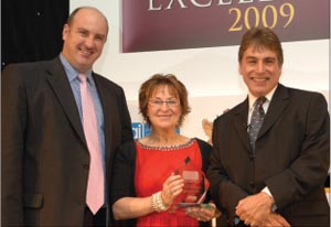 Achiever of the Year: Anne Ganley, managing director,Thompson Building Centres, accepts the award from Andy Williamson, director of IKO (left) and is flanked by host, John Inverdale.
