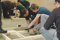 The Wickes team lay out the timber frame.