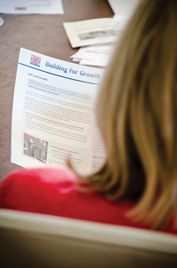 Lib Dem MP Lorely Burt reads the new  Get Britain Building leaflet